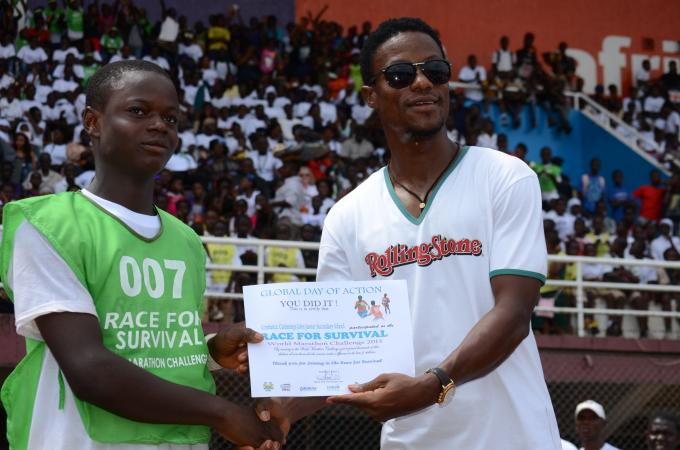 Sierra Leone super star Mohamed Kallon giving out certificates of participation to schools' representatives